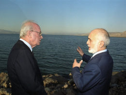 Israeli Prime Minister Yitzhak Rabin and King Hussein of Jordan confer on the Sea of Galilee shore after signing the Israel Jordan peace treaty.