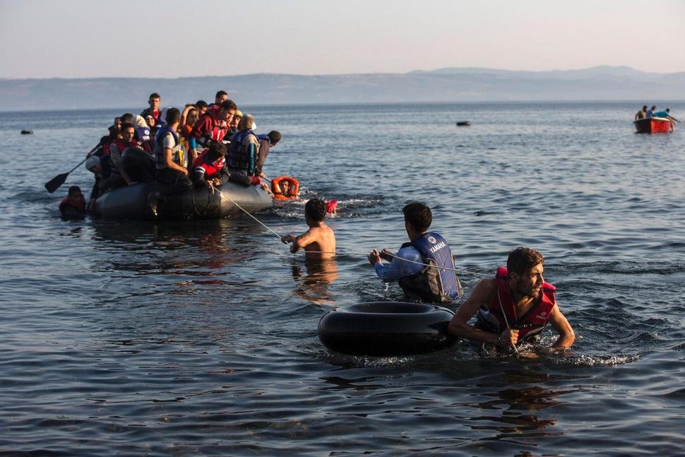 Syrian and Afghan refugees arriving from the Turkish coasts to the Greek coasts July 27, 2015. SANTI PALACIOS/AP