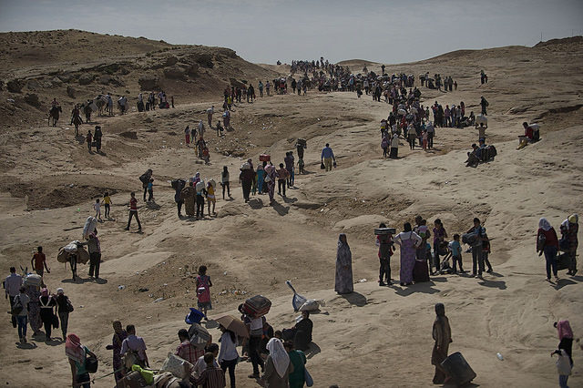 Thousands of Syrians cross from Syria into Northern Iraq near the Peshkhabour border point in Dahuk, Northern Iraq, August 21, 2013.